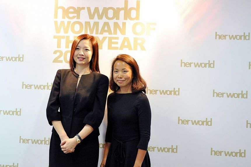 Her World Woman of The Year, lawyer Rachel Eng, 46 (left), and Her World Young Woman Achiever, photojournalist Sim Chi Yin, 35 (right). -- ST PHOTO: RUDY WONG