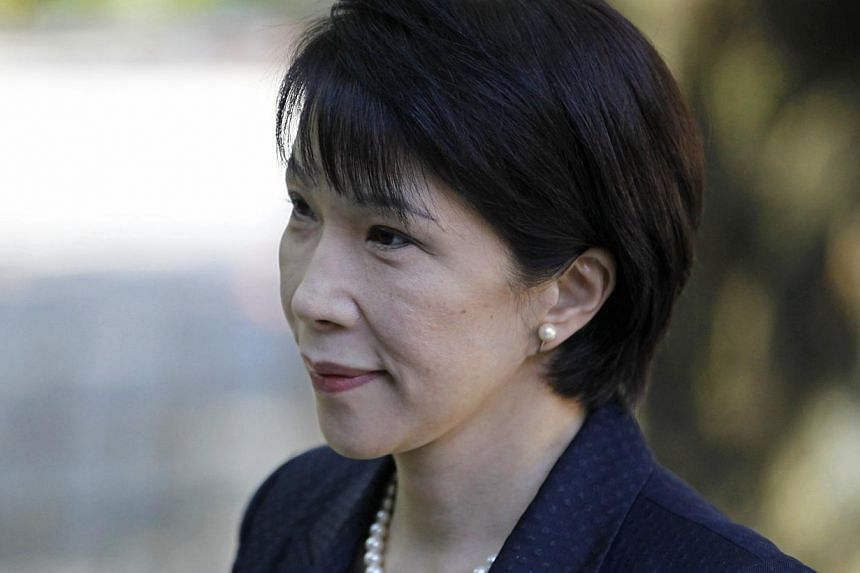 Japan's Internal Affairs and Communications Minister Sanae Takaichi visits the Yasukuni Shrine in Tokyo on Oct 18, 2014. -- PHOTO: REUTERS