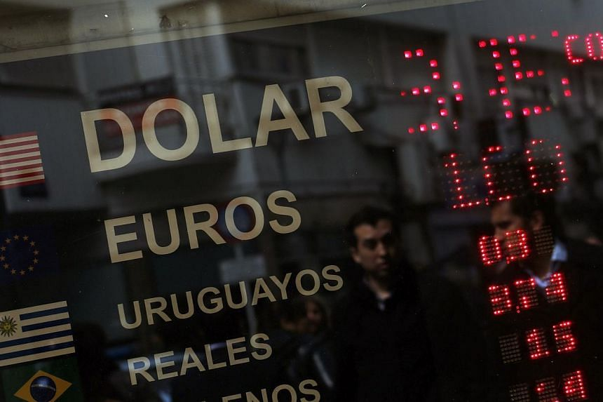 Argentina will launch a new two-year sovereign bond on Oct 23 for up to US$1 billion, denominated in US dollars and paid in the local peso currency, the Economy Ministry said in a statement on Friday. -- PHOTO: REUTERS