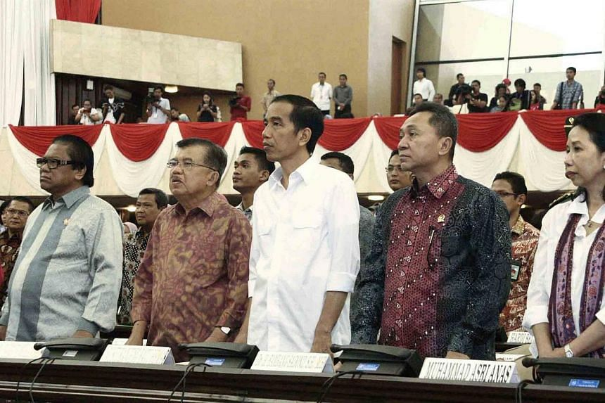 This handout picture released by the House of Representative (MPR) on Oct 18, 2014, shows President-elect Joko Widodo (centre) and Vice-President elect Jusuf Kalla (second, left) accompanied by house speaker, Mr Zulkifli Hassan (second, right), House