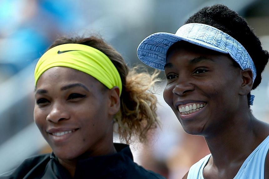 (From left) Serena Williams of the USA and Venus Williams of the USA pose before their women's semifinals match in the Rogers Cup at Uniprix Stadium on Aug 9, 2014 in Montreal, Canada. The president of the Russian Tennis Federation Shamil Tarpischev
