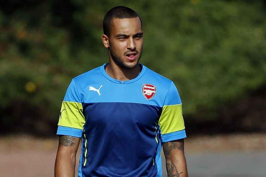 Arsenal's Theo Walcott arrives for a training session at their training facility in London Colney, north of London on Sept 30, 2014.Arsenal winger Theo Walcott played 45 minutes for the club's Under-21 side against Blackburn on Friday as he fin