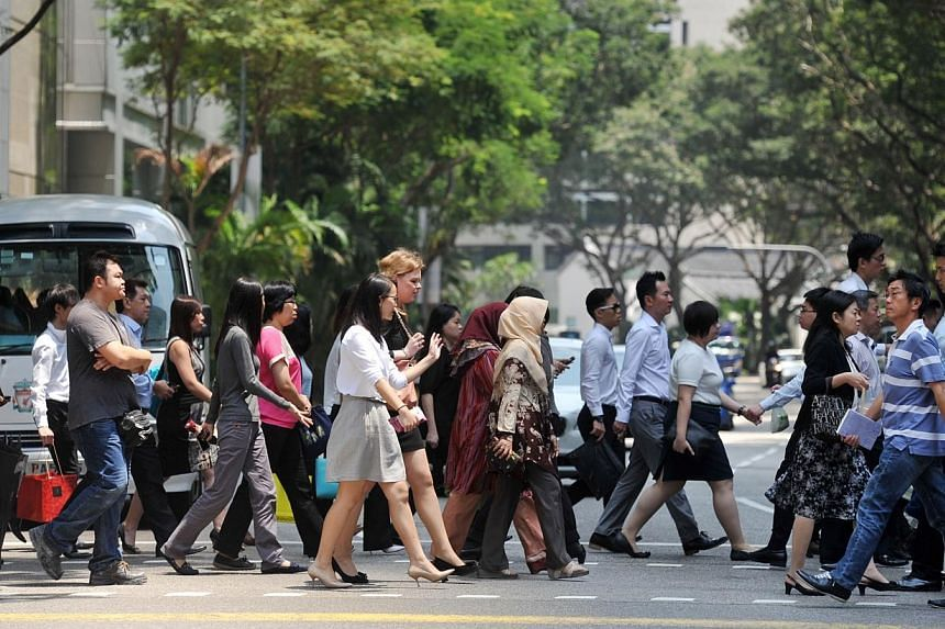 Singapore's policy of slowing the increase in foreign workers could hurt the country's potential growth and lower its competitiveness, the International Monetary Fund (IMF) said in a report issued late Friday. -- PHOTO: ST FILE