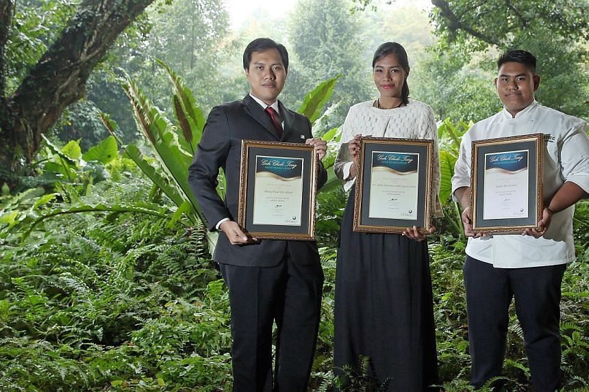 Three of the seven winners of the Goh Chok Tong Youth Promise Award are (from left) Mr Ahmad Fuad Ahiari, Miss Nur Aqilah Afiqah and Mr Syahir Osman. -- ST PHOTO: SEAH KWANG PENG
