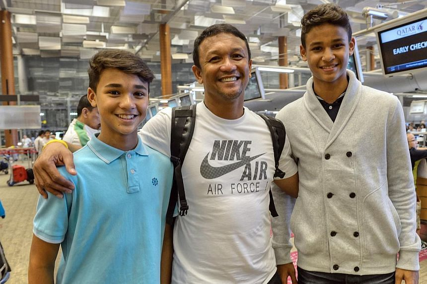 Singapore football legend Fandi Ahmad (centre) with his sons Ikhsan (left) and Irfan at the airport. -- PHOTO: ST FILE