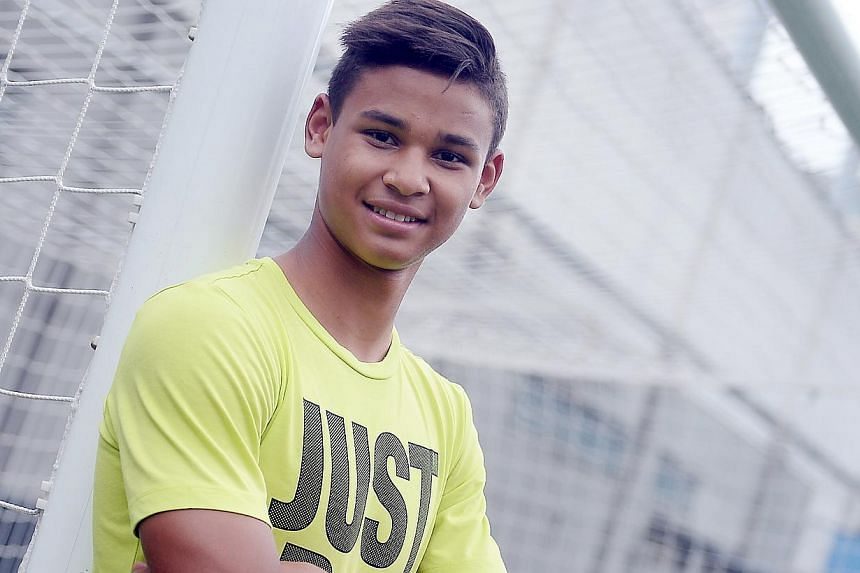 Irfan Fandi, son of Fandi Ahmad, inked a one-year athlete sponsorship agreement with Malaysian bank CIMB on July 31, 2014. -- PHOTO: BERITA HARIAN FILE