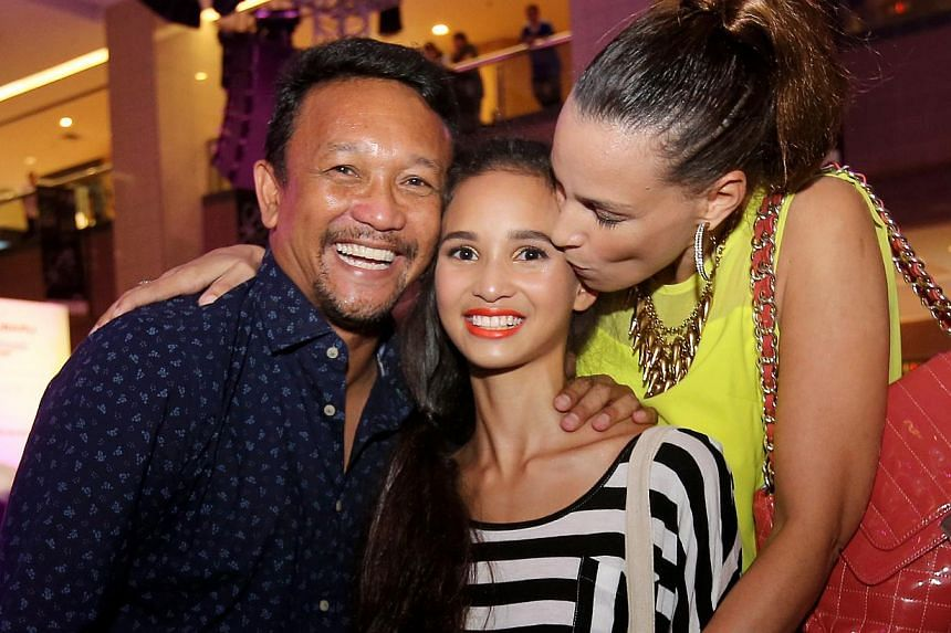 Fandi Ahmad with daughter Iman Fandi and wife Wendy Jacobs, during The New Paper New Face 2014 Grand Final. -- PHOTO: THE NEW PAPER