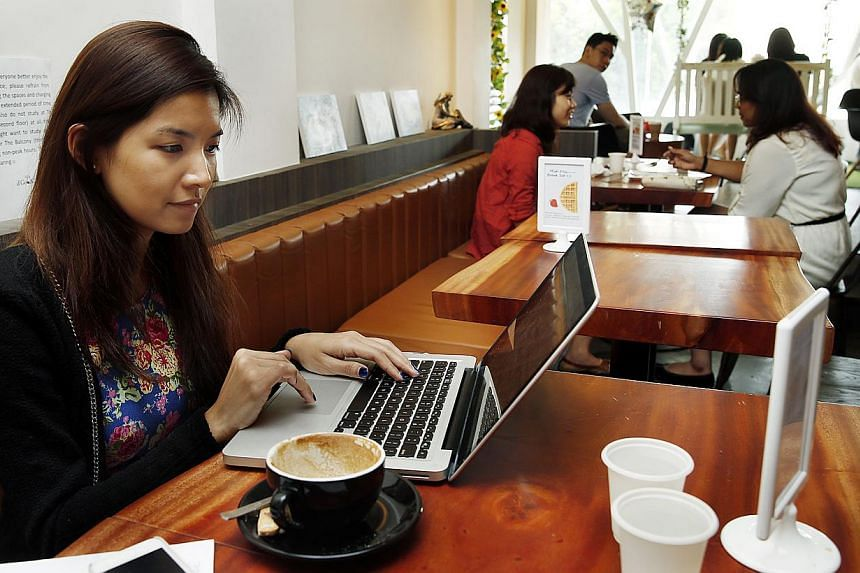 Computer users may want to hold off e-banking or even checking their e-mail over public Wi-Fi networks until Web browser makers fix a newly discovered flaw. -- PHOTO: ST FILE