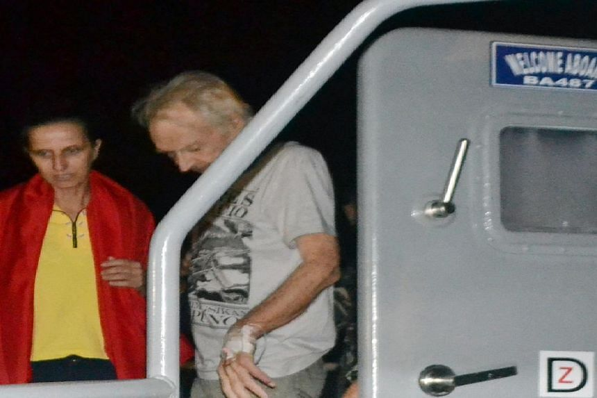 The two Germans kidnapped by Islamic militants, Stefan Okonek (right), and his partner Henrike Dielen, disembarking from a Philippine navy boat in Zamboanga city, on the southern island of Mindanao, after arriving from Jolo island.