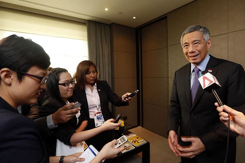 Prime Minister Lee Hsien Loong speaking with Singapore media at the Asem summit in Milan on Oct 17, 2014. -- ST PHOTO: CHEW SENG KIM