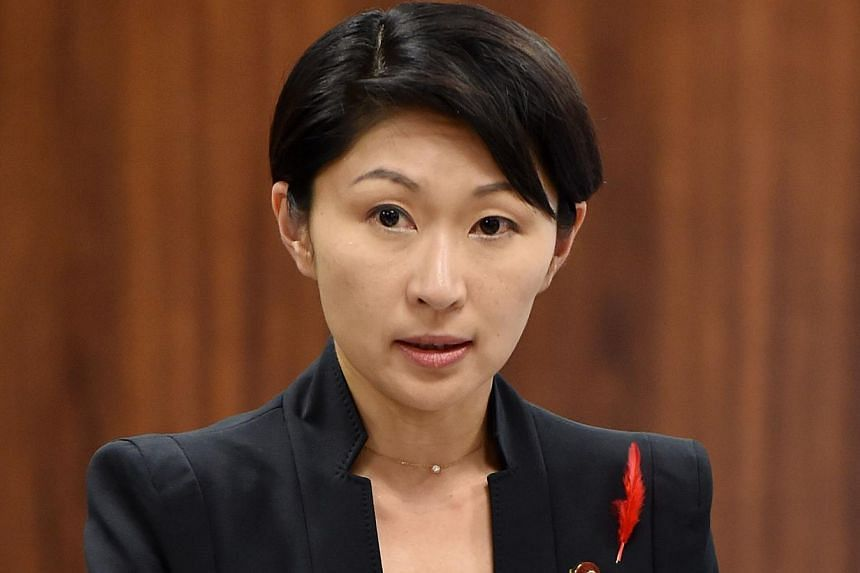 Japan's Economy, Trade and Industry Minister Yuko Obuchi answers questions during a committee session of economy, trade and industry of the House of Councilors at the Parliament in Tokyo on Oct 16, 2014. -- PHOTO: AFP