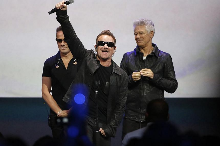 U2 frontman Bono (centre) in his trademark dark glasses after performing at an Apple event at the Flint Centre in Cupertino, California on Sept 9, 2014. Bono revealed in a British TV interview to be broadcast on Friday that he has suffered from glauc