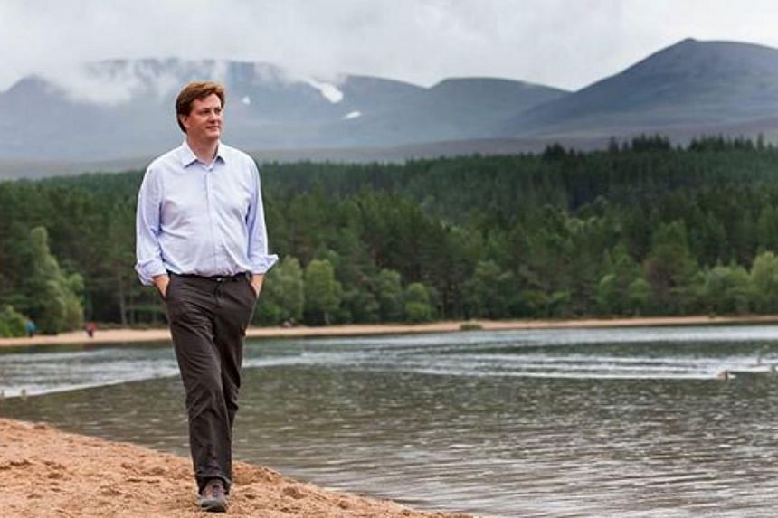 British MP Danny Alexander, who posted a photograph of himself walking along a beach in an open-neck shirt and minus glasses on his Facebook page, has become the subject of ridicule on social media after a series of hilarious memes started making the