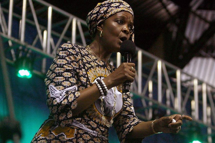 Zimbabwe's first lady Grace Mugabe speaks during a campaign meeting at the City Sports Centre in Harare, Oct 8, 2014. President RobertMugabe's increasingly powerful wife Grace has threatened Zimbabwe's vice-president with expulsion from the rul
