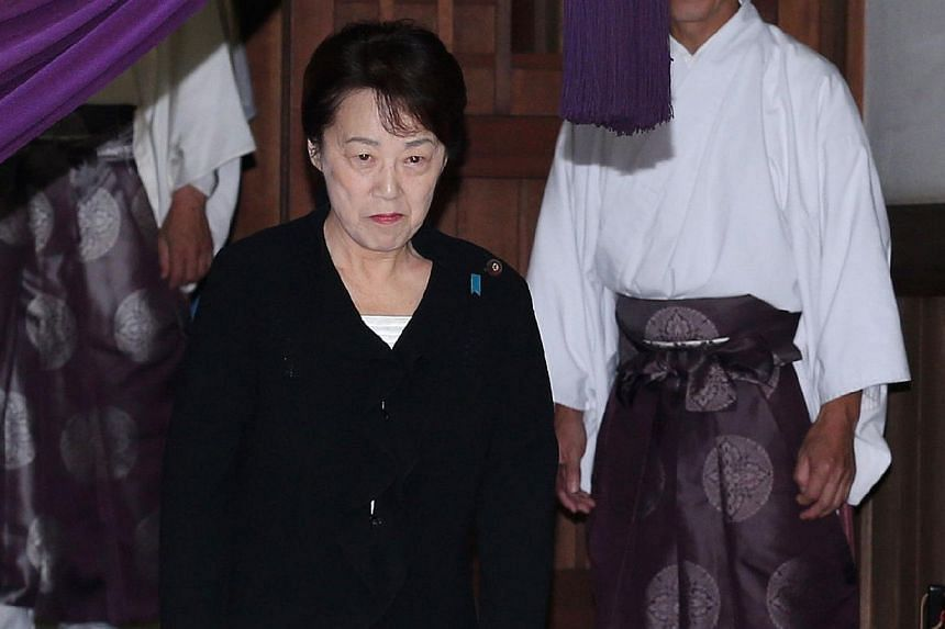 Japanese National Public Safety Commission chief Eriko Yamatani leaving the controversial Yasukuni shrine in Tokyo as she visits the shrine for the shrine's autumn festival on October 18, 2014. -- PHOTO: AFP