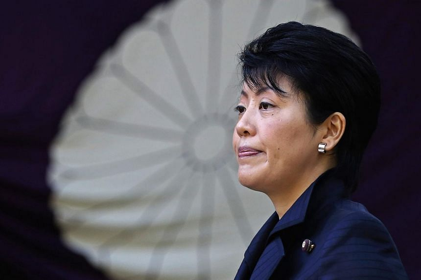 Japan's Gender Equality Minister Haruko Arimura listening to questions from the media after visiting the Yasukuni Shrine in Tokyo on October 18, 2014. Three Japanese cabinet members, including Ms Arimura, visited the shrine for war dead on Saturday a
