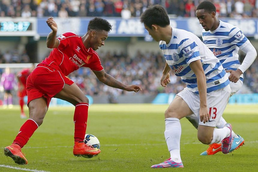 Queens Park Rangers Yoon Suk-Young (centre) and Leroy Fer (right) challenge Liverpool's Raheem Sterling during their English Premier League football match at Loftus Road in London on October 19, 2014. -- PHOTO: REUTERS