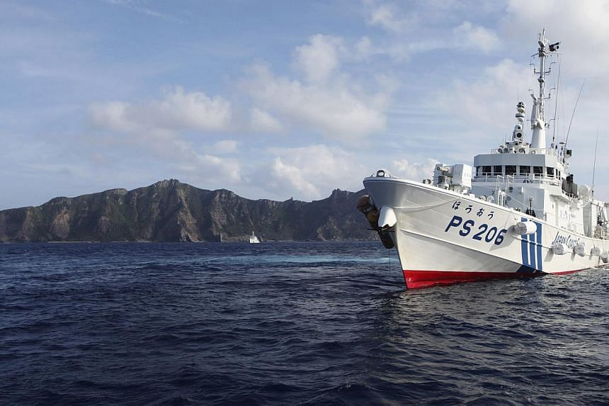 Japan Coast Guard vessel PS206 Houou sails in front of Uotsuri island, one of the disputed islands, called Senkaku in Japan and Diaoyu in China, in the East China Sea, in this Aug 18, 2013, file photo.China has sent coastguard vessels to disput