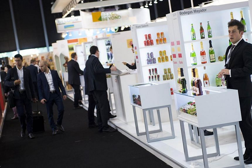 A man waits at the Spanish Bodegas Mayador stand at the SIAL (The Salon International de l'Agroalimentaire), on Oct 19, 2014, in Villepinte east of Paris. -- PHOTO: AFP