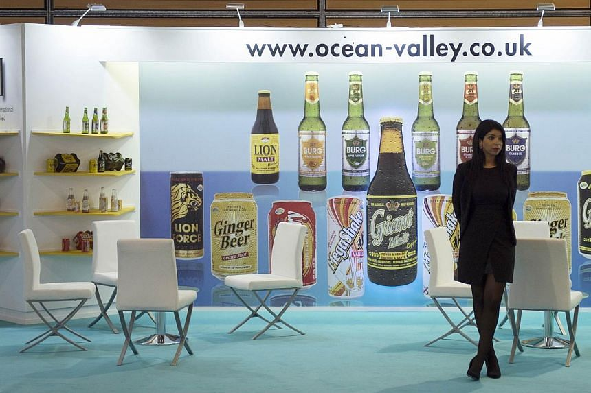 A woman waits in a British stand displaying drinks at the SIAL (Salon International de l'Agroalimentaire, Global Food Show), on Oct 19, 2014, in Villepinte, north-east of Paris. -- PHOTO: AFP