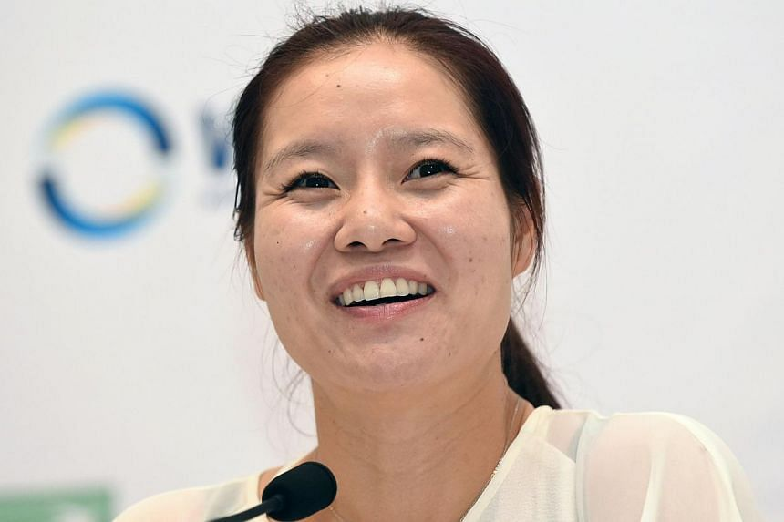 Li Na of China attends a press conference ahead of the Women's Tennis Association (WTA) championships in Singapore on Oct 19, 2014.-- PHOTO: AFP