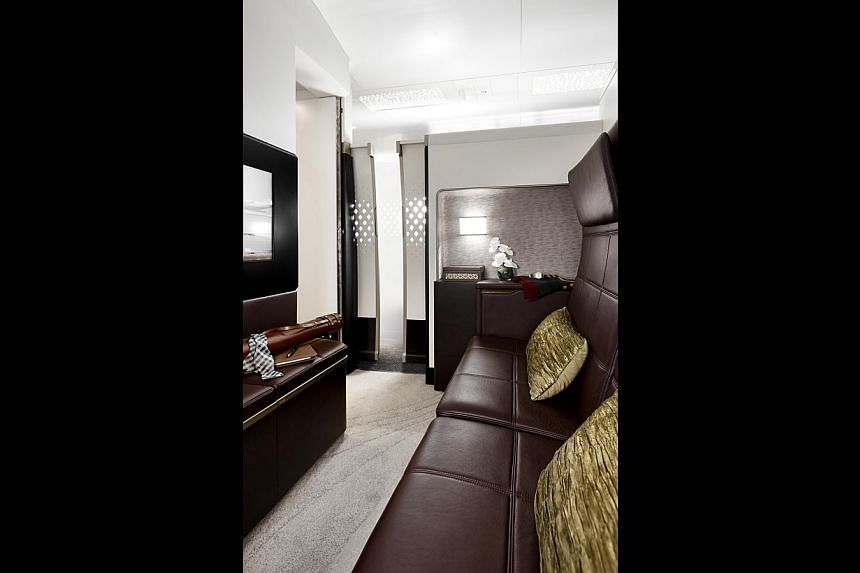 The Residence is a three-room suite that includes a living room (above) and a double bed, while each First Apartment houses a lounge chair and a full-length ottoman that opens into a flat bed.--PHOTO: ETIHAD AIRWAYS