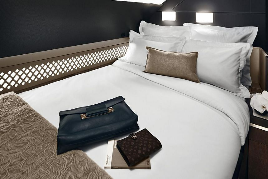 The Residence is a three-room suite that includes a living room and a double bed (above), while each First Apartment houses a lounge chair and a full-length ottoman that opens into a flat bed. --PHOTO: ETIHAD AIRWAYS