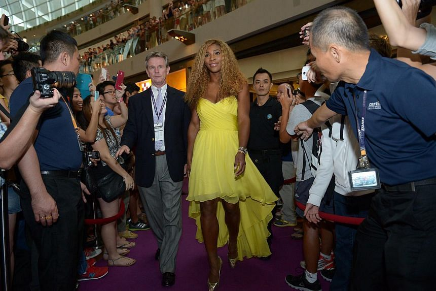 Serena Williams, who won her sixth US Open title last month, makes her entrance on the red carpet at at Marina Bay Sands Shoppes' ice skating rink yesterday.
