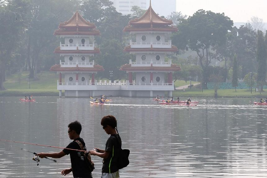 Over 700 young families and residents will be expected to gather at the Jurong Lake to participate in a line-up of environmental conservation activities, including a clean-up of the lake. -- ST PHOTO:NEO XIAOBIN