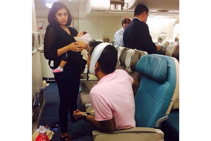 Eight passengers and 14 crew were injured when an SIA plane bound for Mumbai, India, met with serious turbulence. -- PHOTO:ST READER