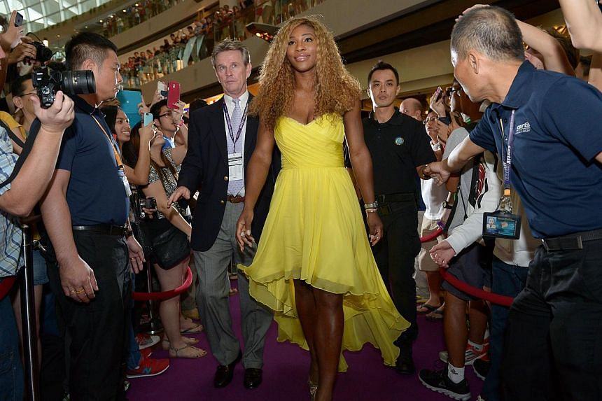 World number one Serena Williams on the red carpet at Marina Bay Sands Shoppes ice skating rink as she arrived for the WTA finals official singles draw ceremony.-- ST PHOTO:DESMOND WEE