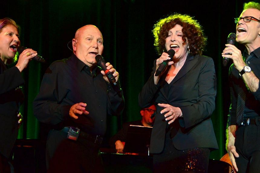 The Manhattan Transfer (Tim Hauser second from left) perform at the San Manuel Amphitheater on April 24, 2014, in San Bernadino, California. Hauser, who founded the Grammy-winning pop-jazz vocal group,died last Thursday in Sayre, Pennsylvania,