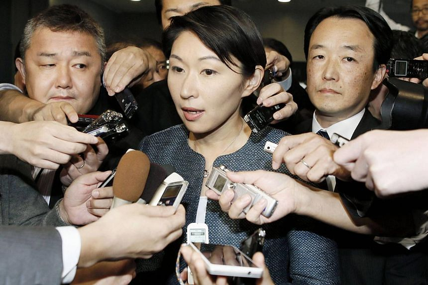Japan's Economy, Trade and Industry Minister Yuko Obuchi (centre) is surrounded by reporters as she speaks in Tokyo, in this photo taken by Kyodo on Oct 18, 2014. -- PHOTO: REUTERS