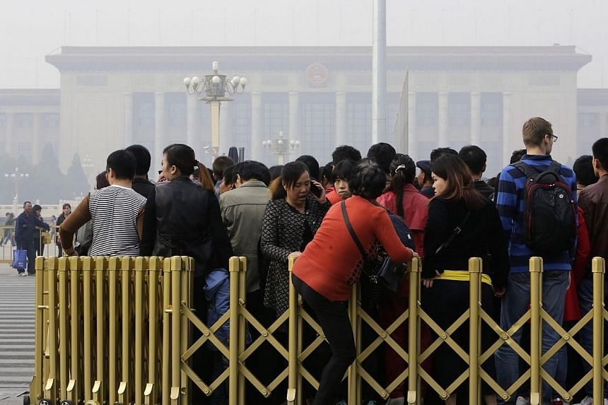 People wait to enter Beijing's Tiananmen Square on a hazy Monday, Oct 20, 2014.Leaders of China's ruling Communist Party opened a highly-anticipated meeting on Monday as state media emphasised the need to strengthen the country's legal system.