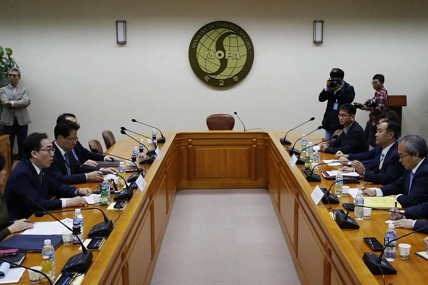 South Korea's Second Vice Minister of Foreign Affairs Cho Tae-yul (3rd left) presides over a meeting regarding sending medics to Africa in response to Ebola, at the Foreign Ministry in Seoul on Oct 20, 2014. -- PHOTO: REUTERS