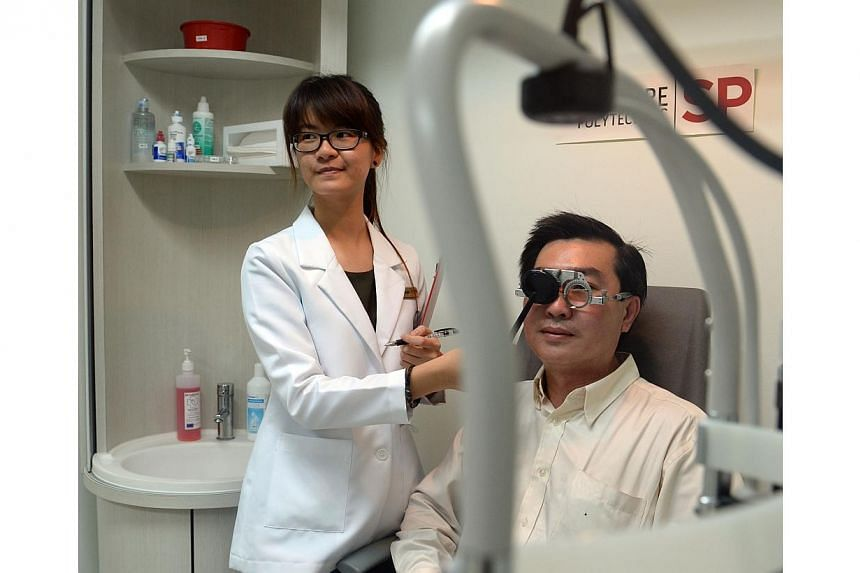 Taxi driver Henry Tay, 44, getting a free eye screening from Ms Khai Siu, 20, a student clinician with Singapore Polytechnic (SP).Close to 2,000 cabbies will get free eye checks and half-priced spectacles from Oct 20 till Dec