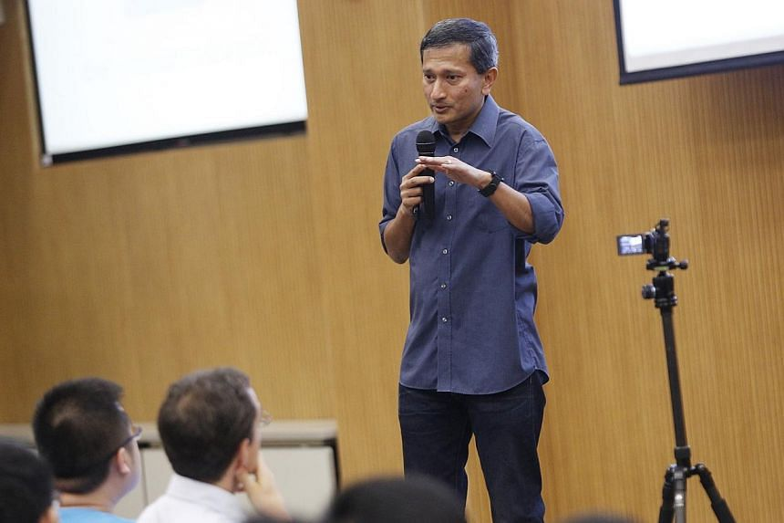 Singapore Minister for Environment and Water Resources Vivian Balakrishnan speaks on his adventures as a tech geek at this year's geekcamp at the NUS School of Computing on 18 Oct, 2014. -- ST PHOTO: DESMOND LUI