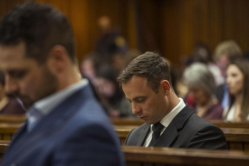 Olympic and Paralympic track star Oscar Pistorius attends his sentencing hearing at the North Gauteng High Court in Pretoria on Oct 17, 2014. TheSouth African fallen star could be jailed for 10 years or return to serve house arrest on Tuesday w