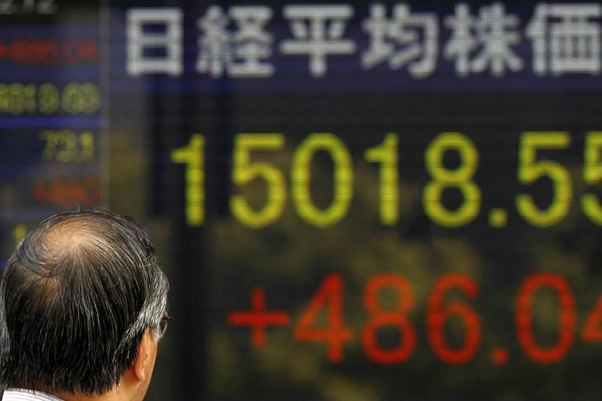 Tokyo stocks jumped 3.98 per cent by the market's close on Monday, following sharp gains on Wall Street and as a weaker yen boosted exporters' shares. -- PHOTO: REUTERS
