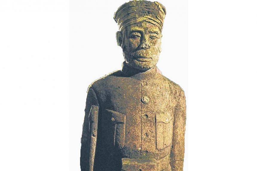 One of the many Sikh guard tombstone statues found at Bukit Brown. -- PHOTO: LIM YAOHUI FOR THE STRAITS TIMES