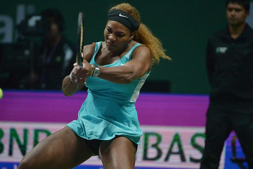 Top seed Serena Williams survived a stern test from Ana Ivanovic and eased concerns over her injured knee as she opened the WTA Finals with a 6-4, 6-4 win on Monday. -- ST PHOTO: CAROLINE CHIA