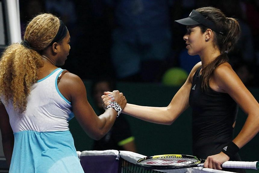 Serena Williams of the US is congratulated by Ana Ivanovic of Serbia during their WTA Finals singles tennis match in Singapore after the American won on Oct 20, 2014. -- PHOTO: REUTERS