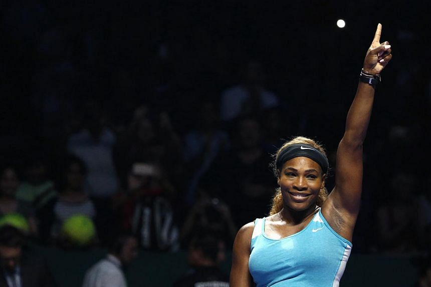 Serena Williams of the US celebrates her victory against Ana Ivanovic of Serbia during their WTA Finals singles tennis match in Singapore on Oct 20, 2014. -- PHOTO: REUTERS