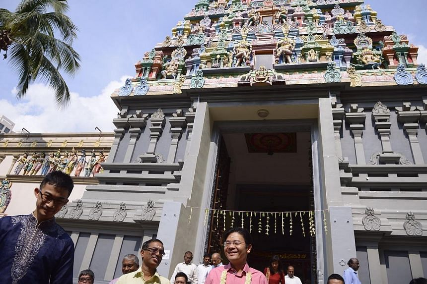 MCCY Minister Lawrence Wong (centre) takes a tour of Sri Thendayuthapani Temple after the official ceremony to gazette it as a national monument on Oct 20, 2014. -- ST PHOTO: MARK CHEONG