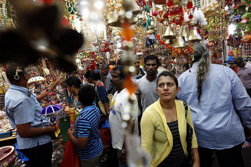 Shoppers browsing festive decorations on sale in the crowded Deepavali bazaar along Campbell Lane in Little India for last minute purchases on Oct 19, 2014. -- ST PHOTO: KEVIN LIM