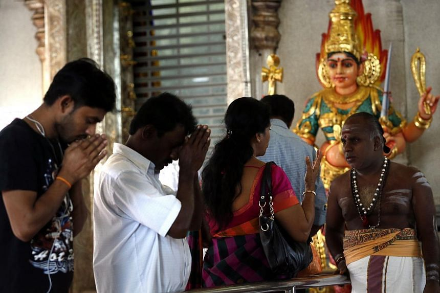 Devotees offer their prayers at Sri Veeramakaliamman Temple in Little India on Oct 19, 2014. -- ST PHOTO: KEVIN LIM