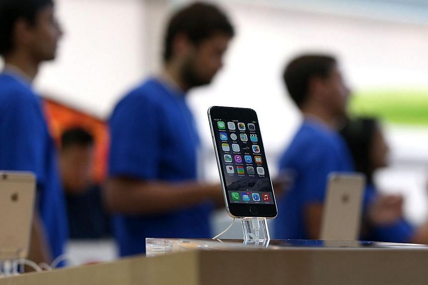 Booming shipments of the iPhone 6 helped Taiwan's export orders jump 12.7 per cent in September year-on-year to a record US$43.3 billion (S$55 billion), the government said on Monday. -- PHOTO: AFP