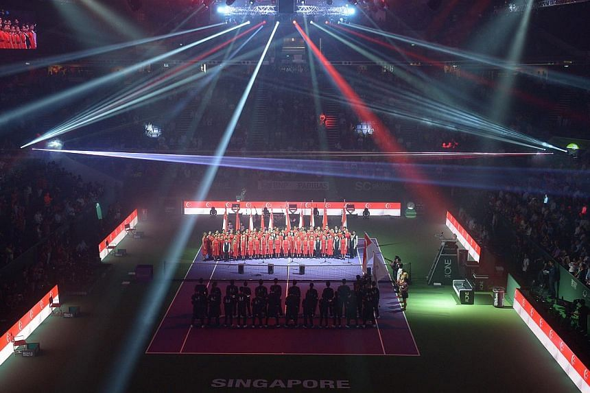 The BNP Paribas Women's Tennis Association (WTA) Finals got off to a bright start at the Singapore Indoor Stadium in an opening ceremony marked by a dazzling light display and live performances. -- ST PHOTO: CAROLINE CHIA