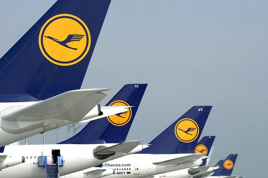 Picture taken on Sept 10, 2014 shows aircrafts of German airline Lufthansa standing at the park position at the Franz-Josef-Strauss-Airport in Munich, southern Germany, during a strike of pilots. -- PHOTO: AFP
