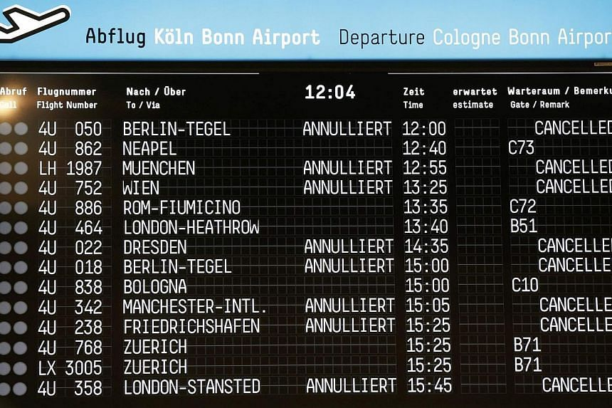 An electronic information board shows cancelled flights at Cologne-Bonn airport on Oct 16, 2014. -- PHOTO: REUTERS